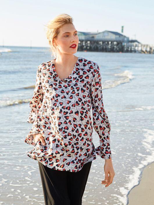 Блуза просторого крою зі складками на рукавах