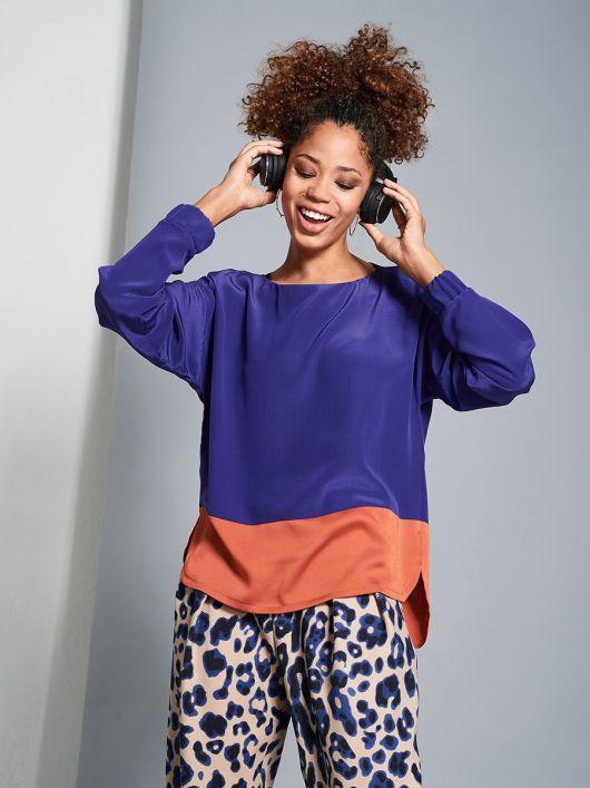 Блуза просторого крою із видовженою спинкою