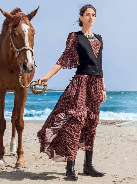 Сукня з оборками плісе і максі-спідницею