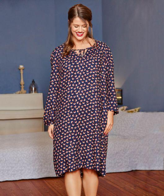 Розкльошена сукня з асиметричним низом
