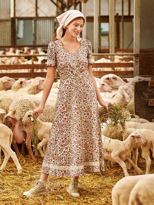 Сукня міді із наскрізною застібкою
