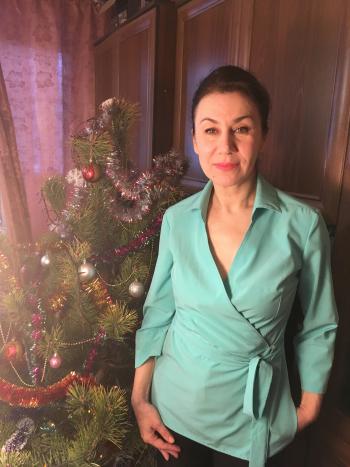 Бірюзова блузка