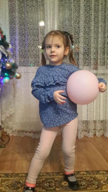 Блуза з оборками для дівчинки